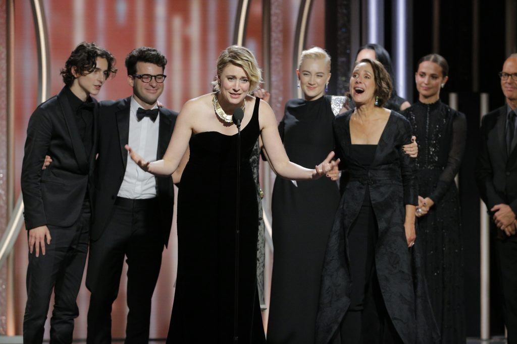 """BEVERLY HILLS, CA - JANUARY 07:  In this handout photo provided by NBCUniversal, Writer/director  Greta Gerwig accepts the award for Best Picture – Comedy or Musical for """"Lady Bird"""" during the 75th Annual Golden Globe Awards at The Beverly Hilton Hotel on January 7, 2018 in Beverly Hills, California.  (Photo by Paul Drinkwater/NBCUniversal via Getty Images)"""