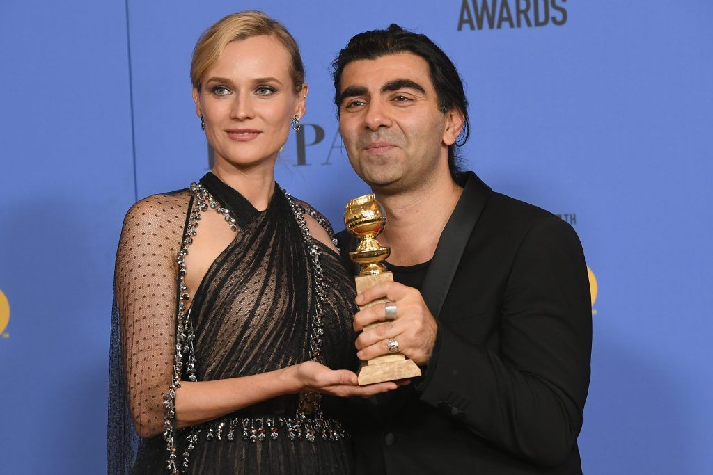 BEVERLY HILLS, CA - JANUARY 07:  Actor Diane Kruger poses with director Fatih Akin and his award for Best Motion Picture Foreign Language (Germany, France) for 'In The Fade' in the press room during The 75th Annual Golden Globe Awards at The Beverly Hilton Hotel on January 7, 2018 in Beverly Hills, California.  (Photo by Kevin Winter/Getty Images)