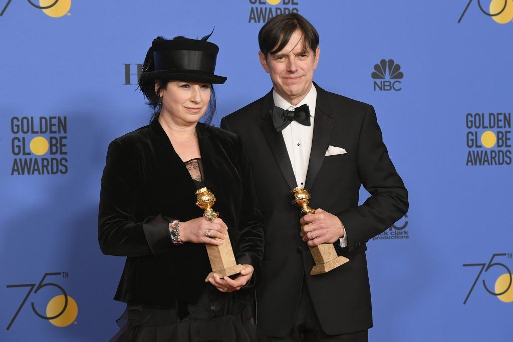 BEVERLY HILLS, CA - JANUARY 07:  Amy Sherman-Palladino and Daniel Palladino pose with the award for Best Television Series Musical or Comedy for 'The Marvelous Mrs. Maisel' in the press room during The 75th Annual Golden Globe Awards at The Beverly Hilton Hotel on January 7, 2018 in Beverly Hills, California.  (Photo by Kevin Winter/Getty Images)