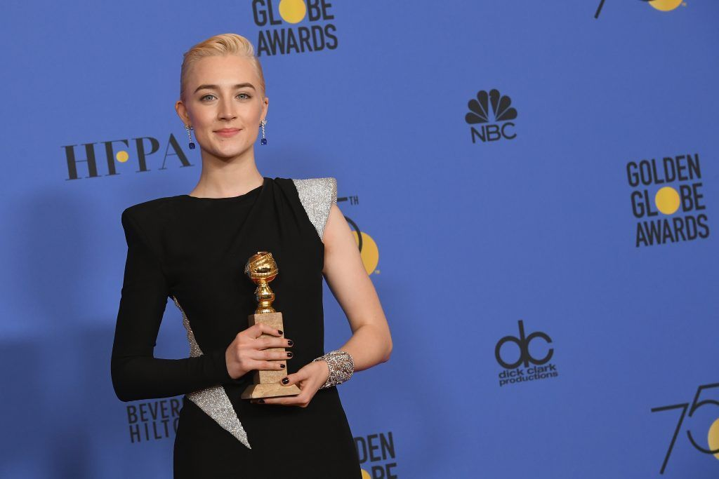 BEVERLY HILLS, CA - JANUARY 07:  Actress Saoirse Ronan poses with the award for Best Performance by an Actress in a Motion Picture Musical or Comedy in 'Lady Bird' in the press room during The 75th Annual Golden Globe Awards at The Beverly Hilton Hotel on January 7, 2018 in Beverly Hills, California.  (Photo by Kevin Winter/Getty Images)