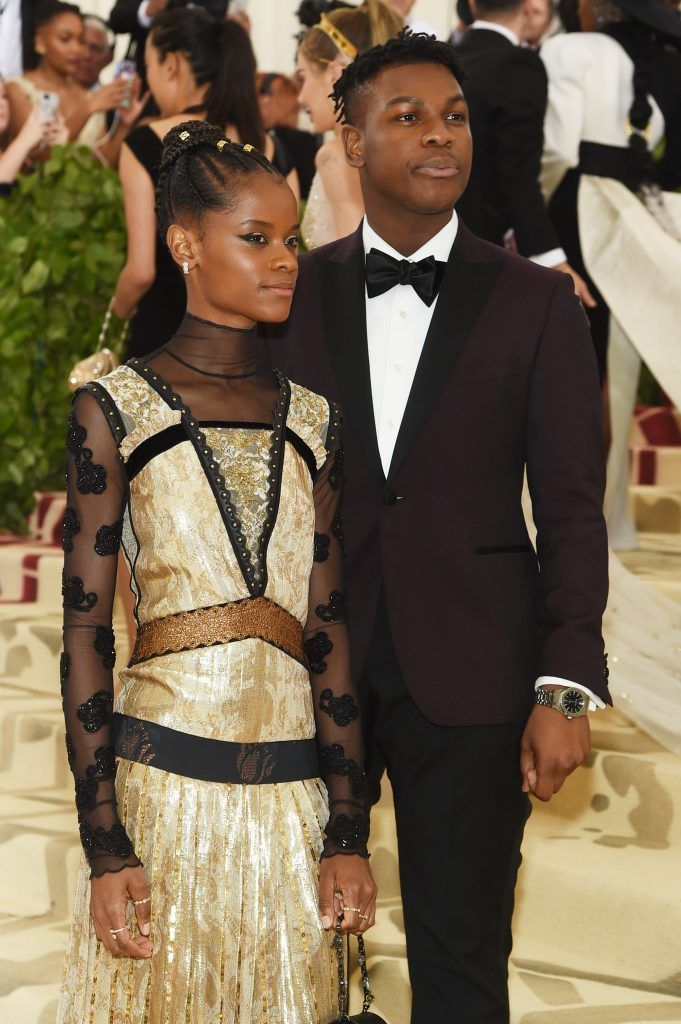 NEW YORK, NY - MAY 07:  Letitia Wright and John Boyega attend the Heavenly Bodies: Fashion & The Catholic Imagination Costume Institute Gala at The Metropolitan Museum of Art on May 7, 2018 in New York City.  (Photo by Jamie McCarthy/Getty Images)