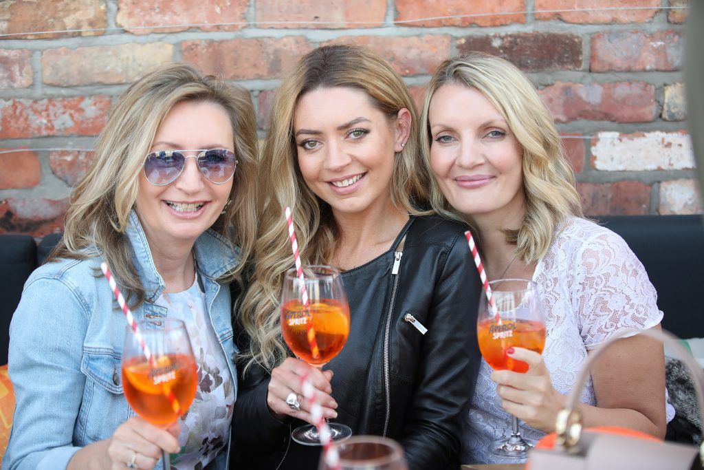 Anne Downey, Sarah McGuinness and Simone Ceillier pictured as Aperol Spritz, Italy's favourite aperitif, unveiled a new home in Dublin, Terrazza Aperol at Sophie's. Photo by Julien Behal