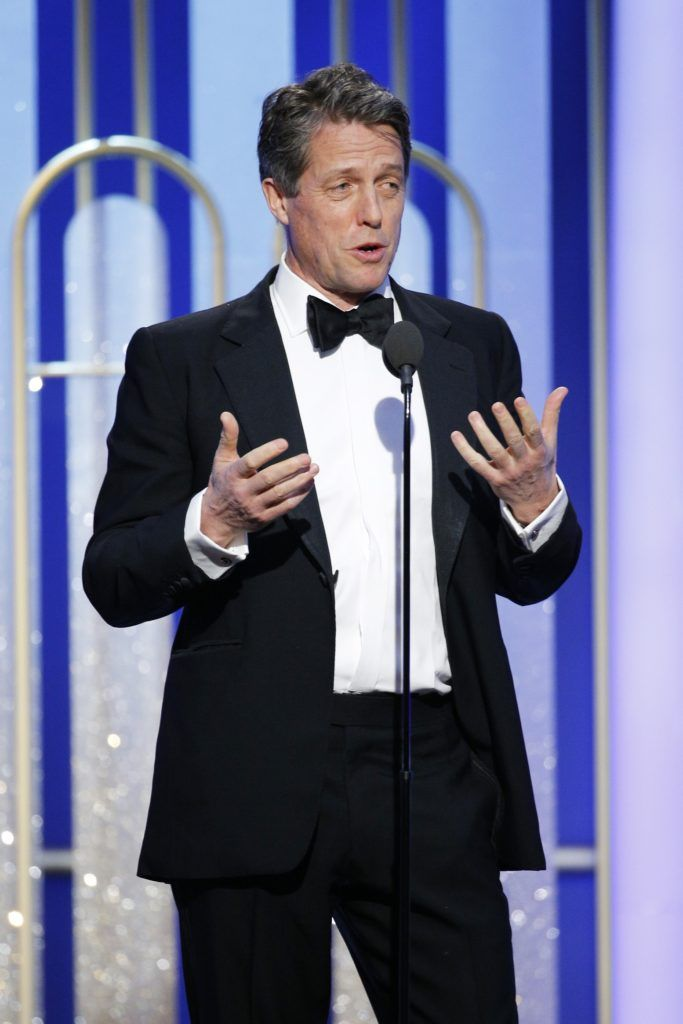 BEVERLY HILLS, CA - JANUARY 08: In this handout photo provided by NBCUniversal, presenter Hugh Grant onstage during the 74th Annual Golden Globe Awards at The Beverly Hilton Hotel on January 8, 2017 in Beverly Hills, California. (Photo by Paul Drinkwater/NBCUniversal via Getty Images)