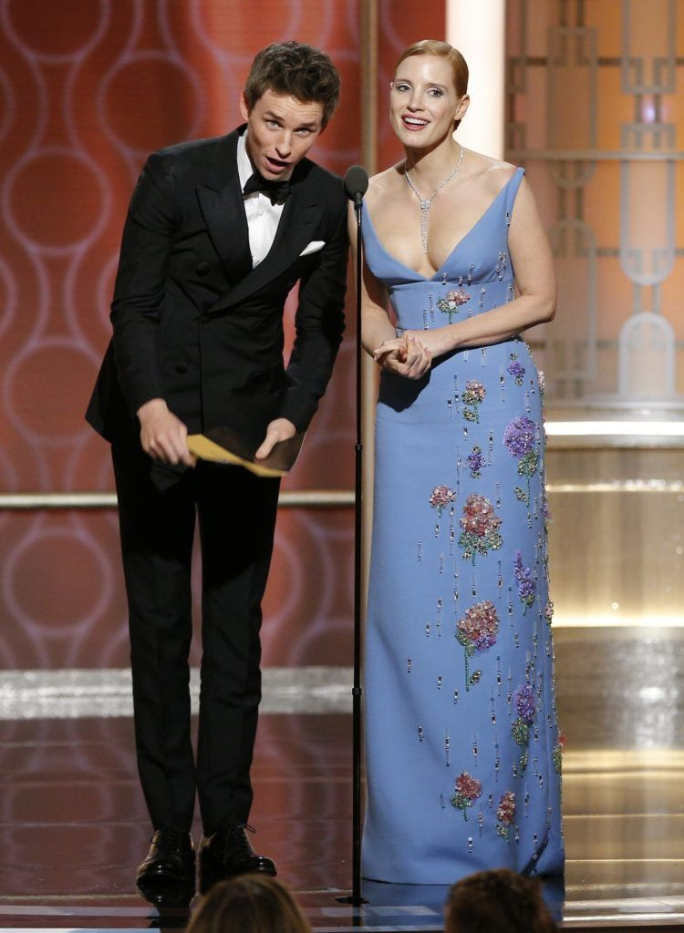 BEVERLY HILLS, CA - JANUARY 08: In this handout photo provided by NBCUniversal, presenters Eddie Redmayne (L) and Jessica Chastain onstage during the 74th Annual Golden Globe Awards at The Beverly Hilton Hotel on January 8, 2017 in Beverly Hills, California. (Photo by Paul Drinkwater/NBCUniversal via Getty Images)
