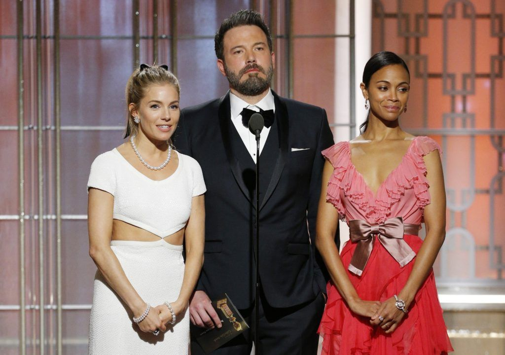 BEVERLY HILLS, CA - JANUARY 08: In this handout photo provided by NBCUniversal, (L-R) presenters Sienna Miller, Ben Affleck and Zoe Saldana onstage during the 74th Annual Golden Globe Awards at The Beverly Hilton Hotel on January 8, 2017 in Beverly Hills, California. (Photo by Paul Drinkwater/NBCUniversal via Getty Images)