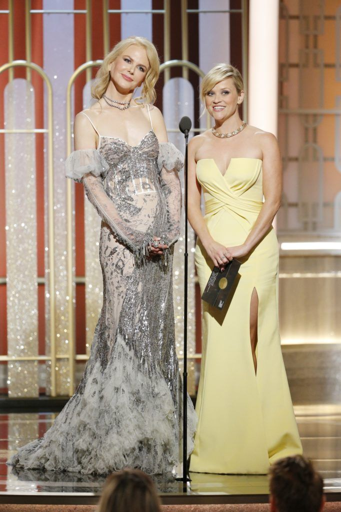 BEVERLY HILLS, CA - JANUARY 08: In this handout photo provided by NBCUniversal, presenters Nicole Kidman (L) and Reese Witherspoon onstage during the 74th Annual Golden Globe Awards at The Beverly Hilton Hotel on January 8, 2017 in Beverly Hills, California. (Photo by Paul Drinkwater/NBCUniversal via Getty Images)