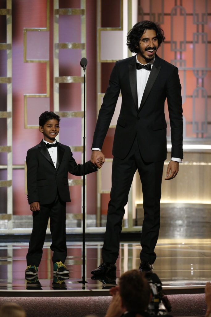 BEVERLY HILLS, CA - JANUARY 08: In this handout photo provided by NBCUniversal, presenters Sunny Pawar (L) and Dev Patel onstage during the 74th Annual Golden Globe Awards at The Beverly Hilton Hotel on January 8, 2017 in Beverly Hills, California. (Photo by Paul Drinkwater/NBCUniversal via Getty Images)