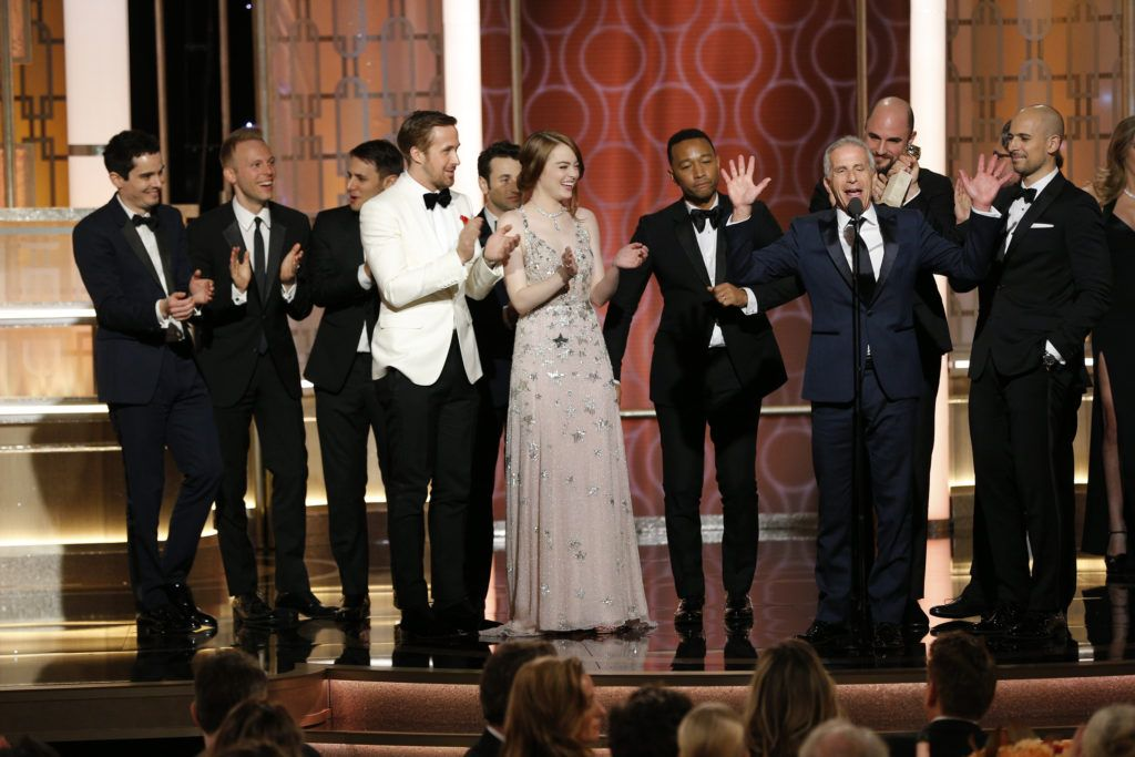 "BEVERLY HILLS, CA - JANUARY 08: In this handout photo provided by NBCUniversal, producer Marc Platt and the cast and crew of ""La La Land"" accept the award for Best Motion Picture - Musical or Comedy for ""La La Land"" onstage during the 74th Annual Golden Globe Awards at The Beverly Hilton Hotel on January 8, 2017 in Beverly Hills, California. (Photo by Paul Drinkwater/NBCUniversal via Getty Images)"