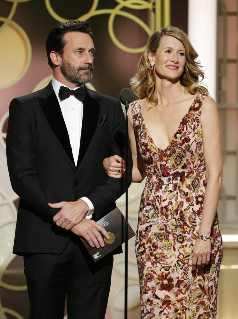 BEVERLY HILLS, CA - JANUARY 08: In this handout photo provided by NBCUniversal, presenters Jon Hamm (L) and Laura Dern onstage during the 74th Annual Golden Globe Awards at The Beverly Hilton Hotel on January 8, 2017 in Beverly Hills, California. (Photo by Paul Drinkwater/NBCUniversal via Getty Images)