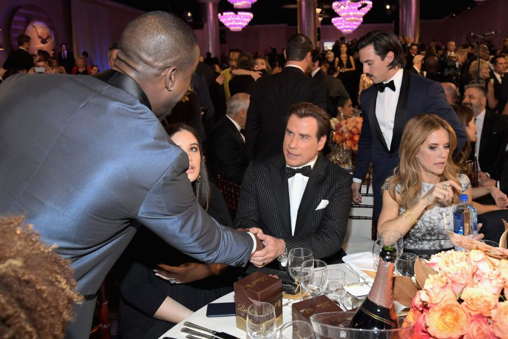 BEVERLY HILLS, CA - JANUARY 08:  Actors Sterling K. Brown (L), John Travolta, Milo Ventimiglia, and Kelly Preston at the 74th annual Golden Globe Awards sponsored by FIJI Water at The Beverly Hilton Hotel on January 8, 2017 in Beverly Hills, California.  (Photo by Charley Gallay/Getty Images for FIJI Water)
