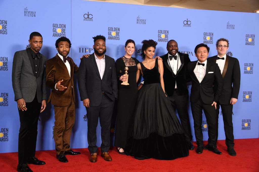 The cast and crew of Atlanta pose with the Best TV Series  Comedy or Musical award in the press room at the 74th annual Golden Globe Awards, January 8, 2017, at the Beverly  Hilton  Hotel in Beverly Hills, California.       (Photo ROBYN BECK/AFP/Getty Images)