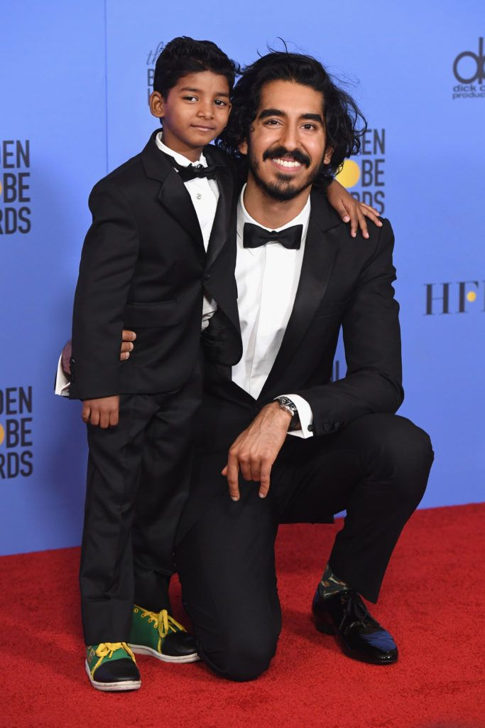 BEVERLY HILLS, CA - JANUARY 08:  Actors Sunny Pawar (L) and Dev Patel pose in the press room during the 74th Annual Golden Globe Awards at The Beverly Hilton Hotel on January 8, 2017 in Beverly Hills, California.  (Photo by Kevin Winter/Getty Images)