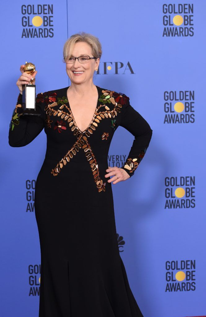 Actress Meryl Streep poses with The Cecil B. DeMille Award in the press room during the 74th Annual Golden Globe Awards at The Beverly Hilton Hotel on January 8, 2017 in Beverly Hills, California.        (Photo ROBYN BECK/AFP/Getty Images)