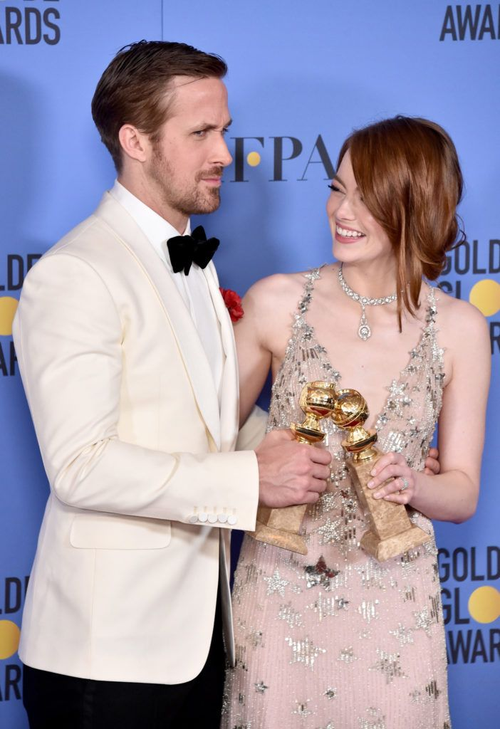 BEVERLY HILLS, CA - JANUARY 08:  Actor Ryan Gosling (L) and actress Emma Stone pose in the press room during the 74th Annual Golden Globe Awards at The Beverly Hilton Hotel on January 8, 2017 in Beverly Hills, California.  (Photo by Alberto E. Rodriguez/Getty Images)