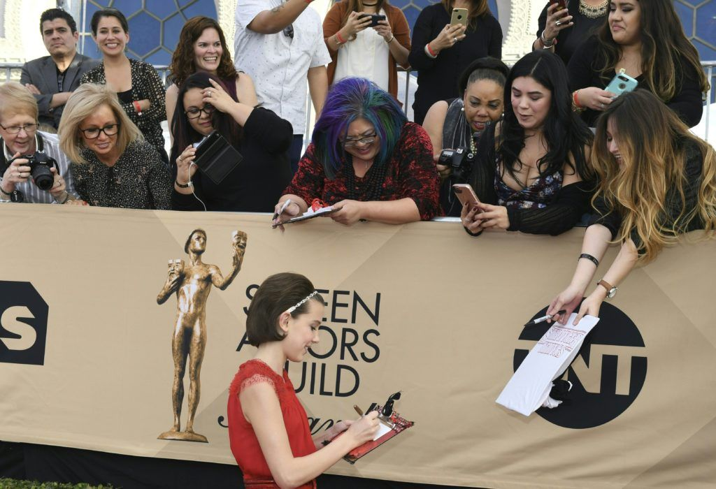 Millie Bobby Brown signs autographs at the 23rd Annual Screen Actors Guild Awards at The Shrine Auditorium on January 29, 2017 in Los Angeles, California.   (Photo MARK RALSTON/AFP/Getty Images)