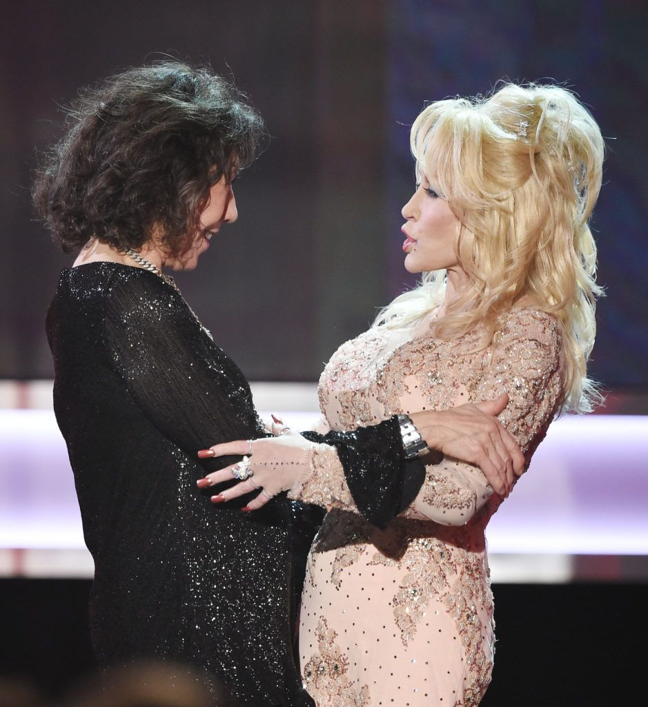 Actor Lily Tomlin (L) accepts the 2016 SAG Life Achievement Award from actor/singer Dolly Parton onstage during the 23rd Annual Screen Actors Guild Awards show at The Shrine Auditorium on January 29, 2017 in Los Angeles, California. (Photo ROBYN BECK/AFP/Getty Images)