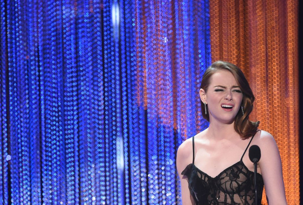 Actress Emma Stone accepts the award for best leading actress for 'La LA Land' during the 23rd Annual Screen Actors Guild Awards show at The Shrine Auditorium on January 29, 2017 in Los Angeles, California. (Photo ROBYN BECK/AFP/Getty Images)