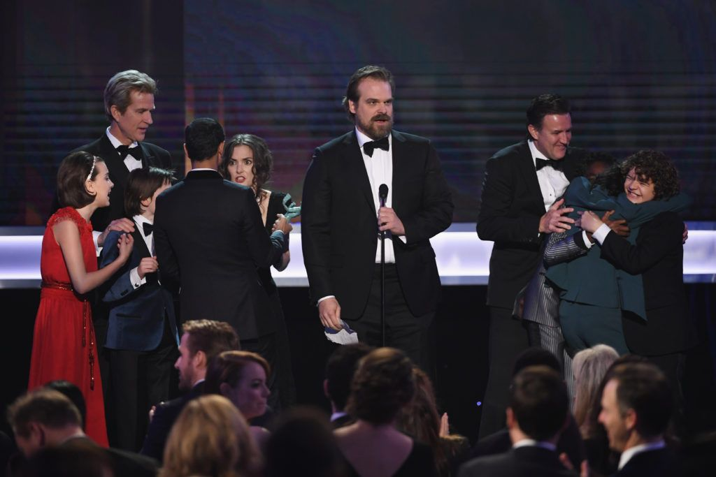 LOS ANGELES, CA - JANUARY 29:  (L-R) Actors Millie Bobby Brown, Noah Schnapp, Matthew Modine, Winona Ryder, David Harbour, Caleb McLaughlin, Finn Wolfhard and Gaten Matarazzo of 'Stranger Things' accept Outstanding Performance by an Ensemble in a Drama Series onstage during The 23rd Annual Screen Actors Guild Awards at The Shrine Auditorium on January 29, 2017 in Los Angeles, California. 26592_014  (Photo by Kevin Winter/Getty Images )