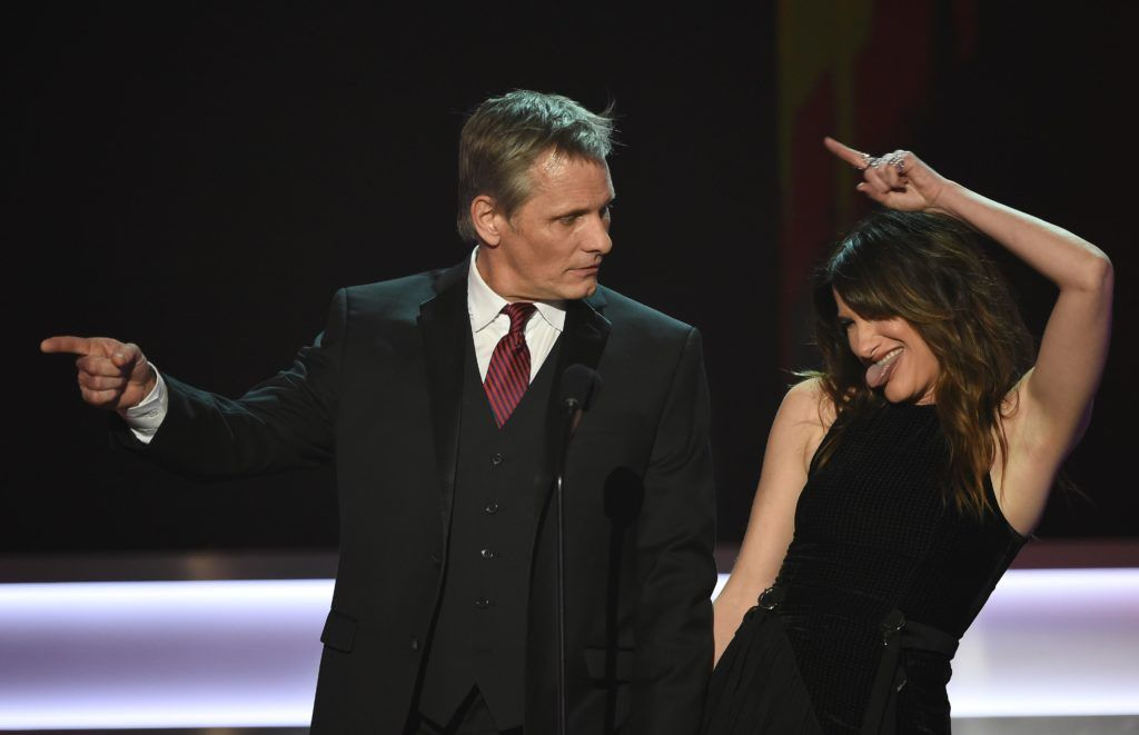 Actor Viggo Mortensen (L) and Actress Kathryn Hahn speak onstage during the 23rd Annual Screen Actors Guild Awards show at The Shrine Auditorium on January 29, 2017 in Los Angeles, California.      (Photo ROBYN BECK/AFP/Getty Images)