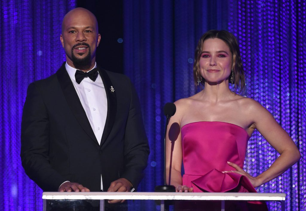 Actor/musician Common (L) and actor Sophia Bush speak onstage during the 23rd Annual Screen Actors Guild Awards show at The Shrine Auditorium on January 29, 2017 in Los Angeles, California. (Photo ROBYN BECK/AFP/Getty Images)