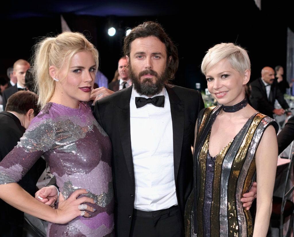 LOS ANGELES, CA - JANUARY 29:  Actors Busy Phillips, Casey Affleck and Michelle Williams attend The 23rd Annual Screen Actors Guild Awards at The Shrine Auditorium on January 29, 2017 in Los Angeles, California. 26592_009  (Photo by Dimitrios Kambouris/Getty Images for TNT)