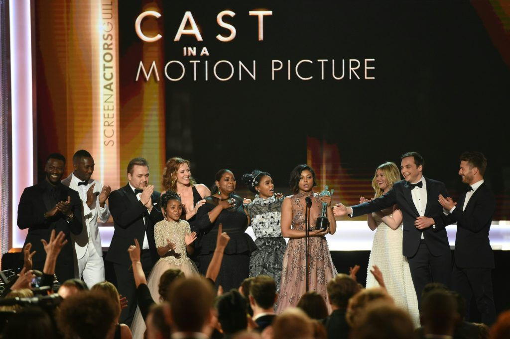 Actress Taraji P. Henson (C) and other cast members accept the award for Outstanding Performance by a Cast in a Motion Picture for 'Hidden Figures' during the 23rd Annual Screen Actors Guild Awards show at The Shrine Auditorium on January 29, 2017 in Los Angeles, California.  (Photo ROBYN BECK/AFP/Getty Images)