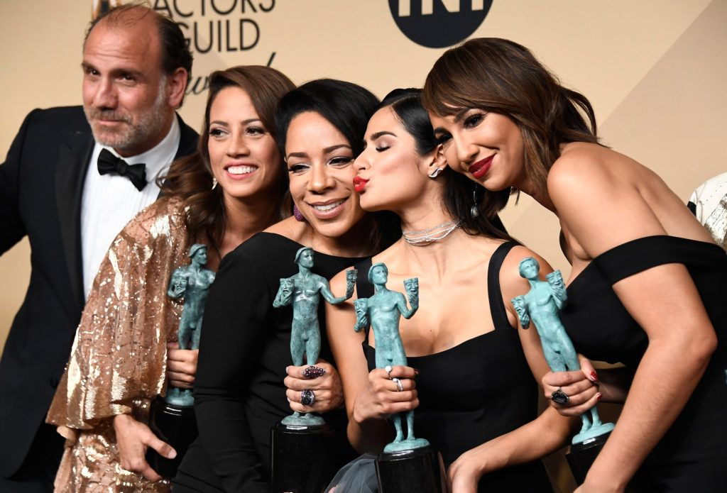 LOS ANGELES, CA - JANUARY 29:  (L-R) Actors Nick Sandow, Elizabeth Rodriguez, Selenis Leyva, Diane Guerrero, and Jackie Cruz, co-winners of the Outstanding Performance by an Ensemble in a Comedy Series award for 'Orange Is the New Black,' pose in the press room during The 23rd Annual Screen Actors Guild Awards at The Shrine Auditorium on January 29, 2017 in Los Angeles, California. 26592_008  (Photo by Frazer Harrison/Getty Images)