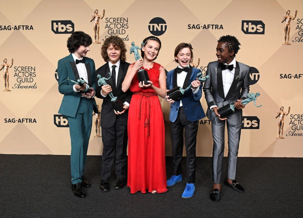 LOS ANGELES, CA - JANUARY 29:  (L-R) Actors Finn Wolfhard, Gaten Matarazzo, Millie Bobby Brown, Noah Schnapp, and Caleb McLaughlin, co-recipients of the Outstanding Performance by an Ensemble in a Drama Series award for 'Stranger Things,' pose in the press room during The 23rd Annual Screen Actors Guild Awards at The Shrine Auditorium on January 29, 2017 in Los Angeles, California. 26592_008  (Photo by Frazer Harrison/Getty Images)