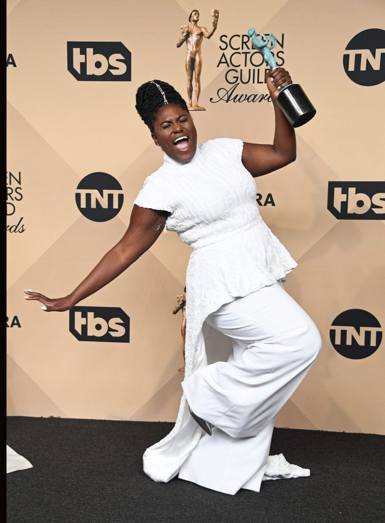 LOS ANGELES, CA - JANUARY 29:  Actor Danielle Brooks, co-winner of the Outstanding Performance by an Ensemble in a Comedy Series award for 'Orange Is the New Black,' poses in the press room during The 23rd Annual Screen Actors Guild Awards at The Shrine Auditorium on January 29, 2017 in Los Angeles, California. 26592_008  (Photo by Frazer Harrison/Getty Images)