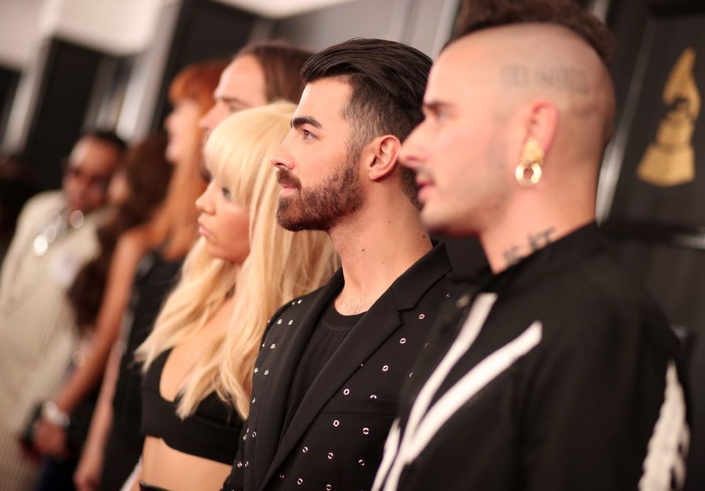 LOS ANGELES, CA - FEBRUARY 12:  (L-R) Musicians Jack Lawless, JinJoo Lee, Joe Jonas and Cole Whittle of DNCE attend The 59th GRAMMY Awards at STAPLES Center on February 12, 2017 in Los Angeles, California.  (Photo by Christopher Polk/Getty Images for NARAS)