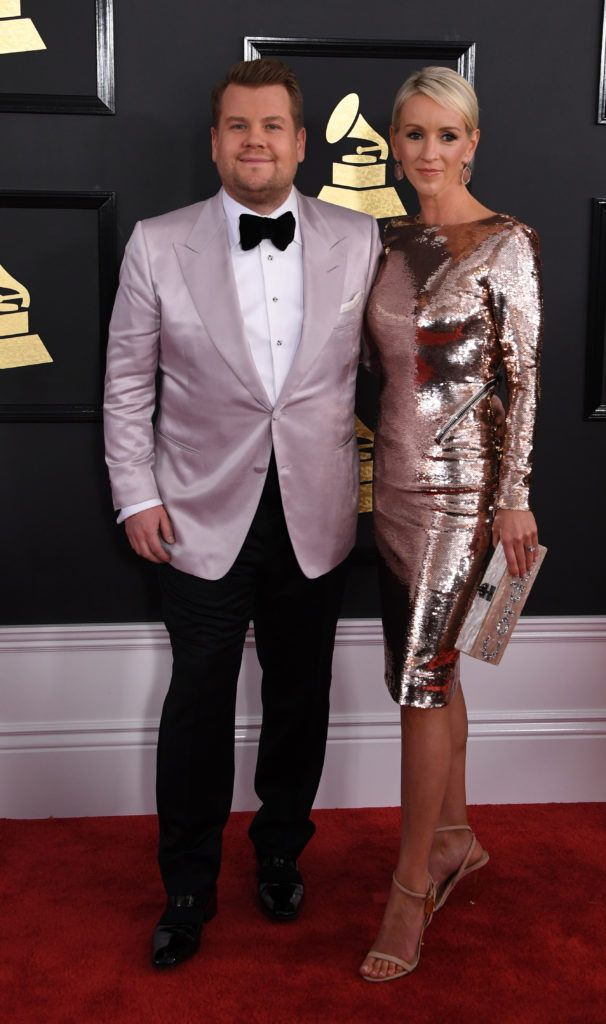 James Corden and Julia Carey arrives for the 59th Grammy Awards on February 12, 2017, in Los Angeles, California.       (Photo MARK RALSTON/AFP/Getty Images)