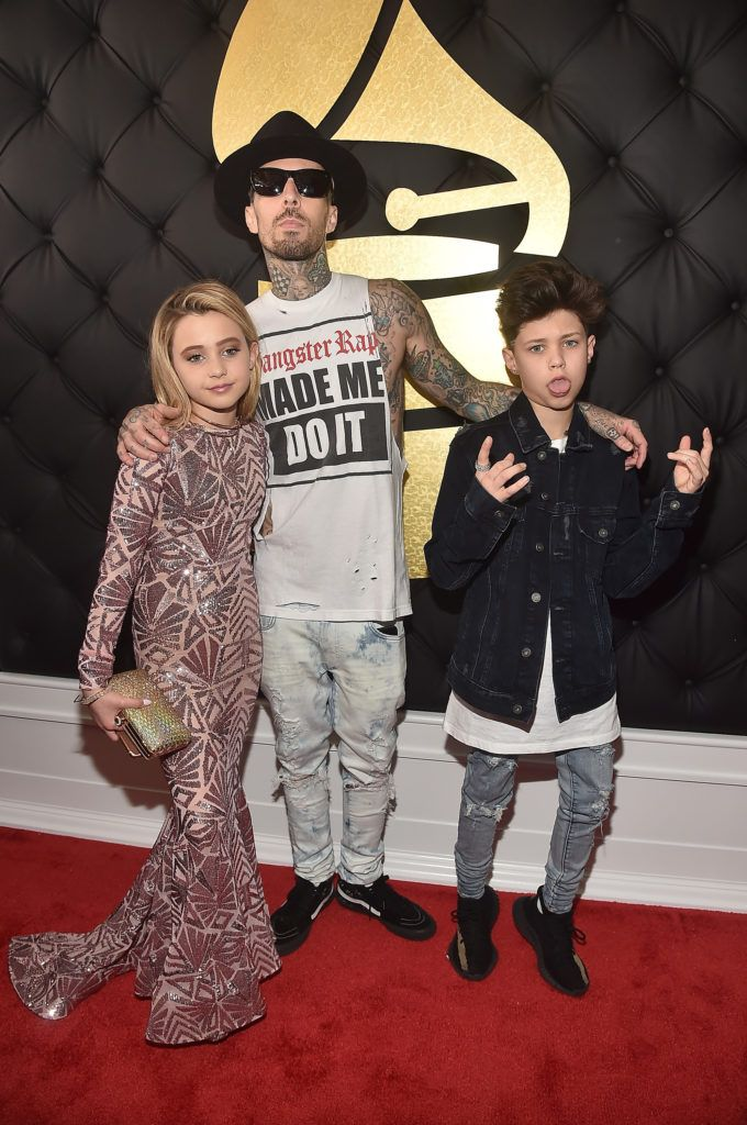 LOS ANGELES, CA - FEBRUARY 12: Musician Travis Barker (C) with children, Alabama Barker and Landon Barker attend The 59th GRAMMY Awards at STAPLES Center on February 12, 2017 in Los Angeles, California.  (Photo by Alberto E. Rodriguez/Getty Images for NARAS)