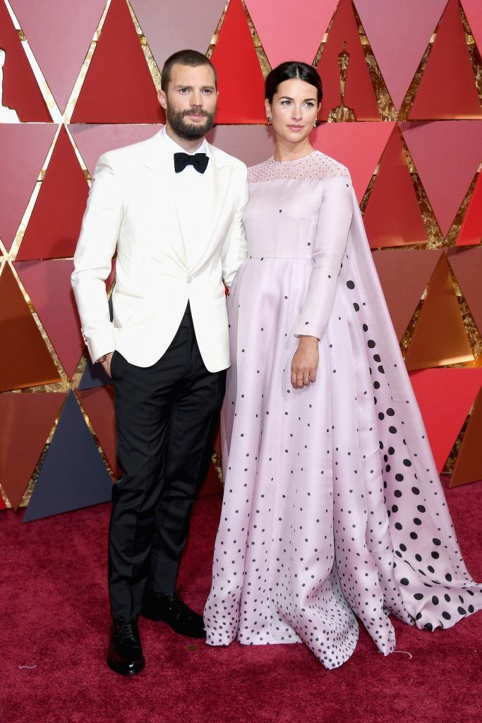 HOLLYWOOD, CA - FEBRUARY 26:  Actors Jamie Dornan (L) and Amelia Warner attend the 89th Annual Academy Awards at Hollywood & Highland Center on February 26, 2017 in Hollywood, California.  (Photo by Kevork Djansezian/Getty Images)