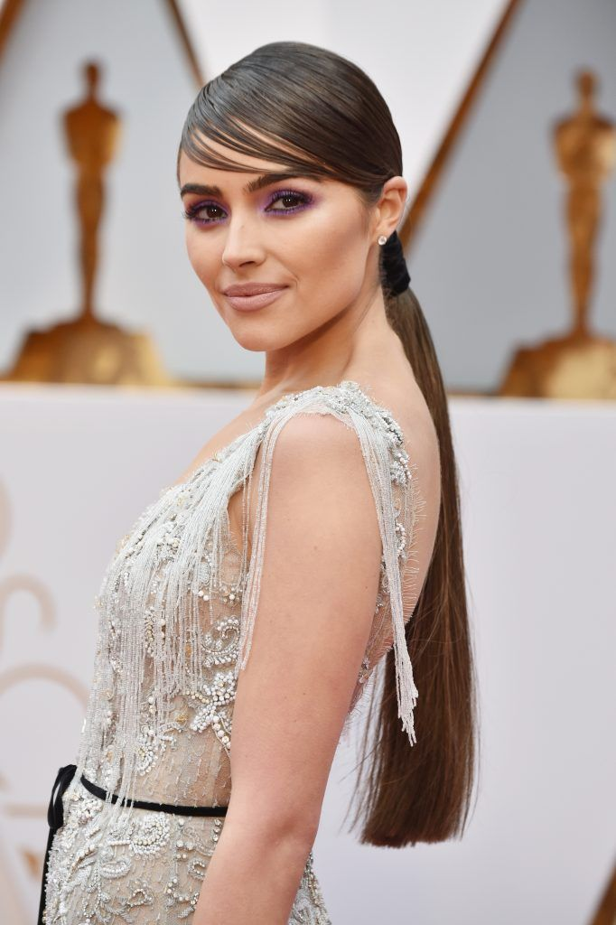 HOLLYWOOD, CA - FEBRUARY 26:  Actor Olivia Culpo unveils a one-of-a-kind Marchesa for Stella Artois gown featuring beads made from the Stella Artois Limited-Edition Chalices that benefit Water.org during the 89th Annual Academy Awards at Hollywood & Highland Center on February 26, 2017 in Hollywood, California.  (Photo by Frazer Harrison/Getty Images)
