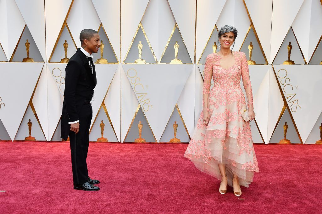 HOLLYWOOD, CA - FEBRUARY 26:  Producers Pharrell Williams (L) and Mimi Valdes attend the 89th Annual Academy Awards at Hollywood & Highland Center on February 26, 2017 in Hollywood, California.  (Photo by Frazer Harrison/Getty Images)