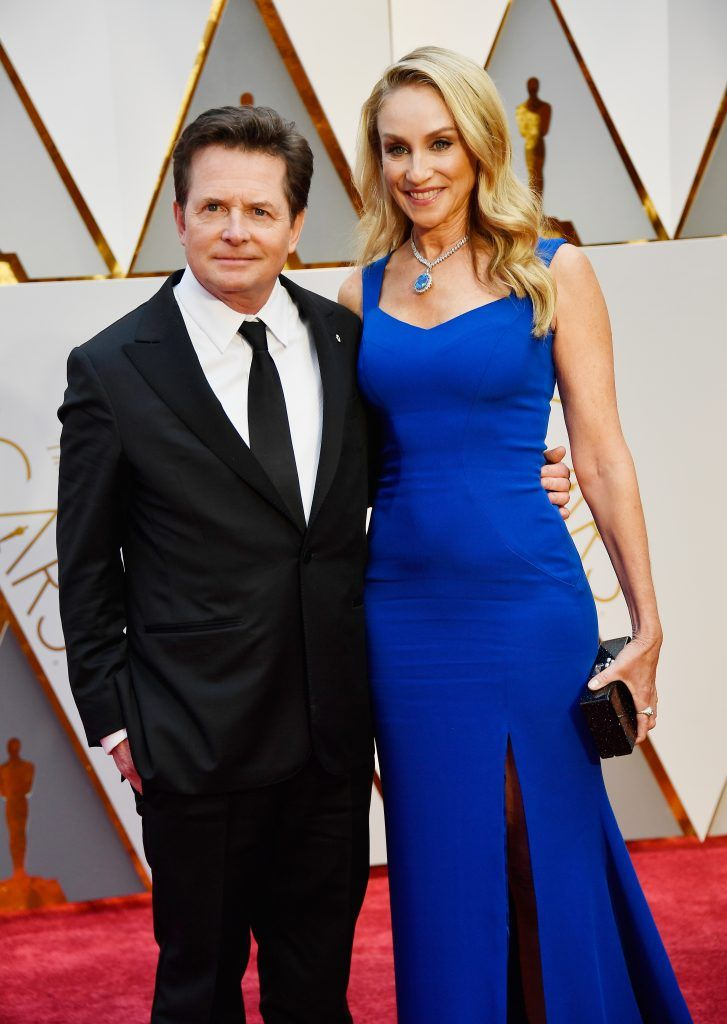 HOLLYWOOD, CA - FEBRUARY 26:  Actors Michael J. Fox (L) and Tracy Pollan attend the 89th Annual Academy Awards at Hollywood & Highland Center on February 26, 2017 in Hollywood, California.  (Photo by Frazer Harrison/Getty Images)
