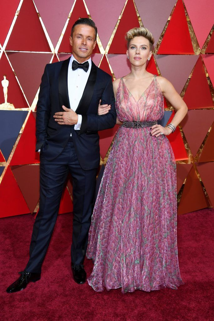 HOLLYWOOD, CA - FEBRUARY 26:  Actor Scarlett Johansson (R) and talent agent Joe Machoda attend the 89th Annual Academy Awards at Hollywood & Highland Center on February 26, 2017 in Hollywood, California.  (Photo by Kevork Djansezian/Getty Images)