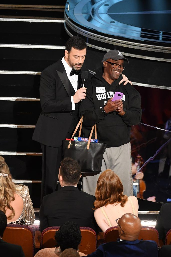 HOLLYWOOD, CA - FEBRUARY 26: Host Jimmy Kimmel (L) surprises tourist with an entrance tothe 89th Annual Academy Awards at Hollywood & Highland Center on February 26, 2017 in Hollywood, California.  (Photo by Kevin Winter/Getty Images)