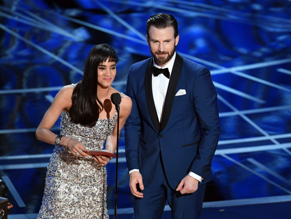 HOLLYWOOD, CA - FEBRUARY 26:  Actors Sofia Boutella (L) and Chris Evans speak onstage during the 89th Annual Academy Awards at Hollywood & Highland Center on February 26, 2017 in Hollywood, California.  (Photo by Kevin Winter/Getty Images)