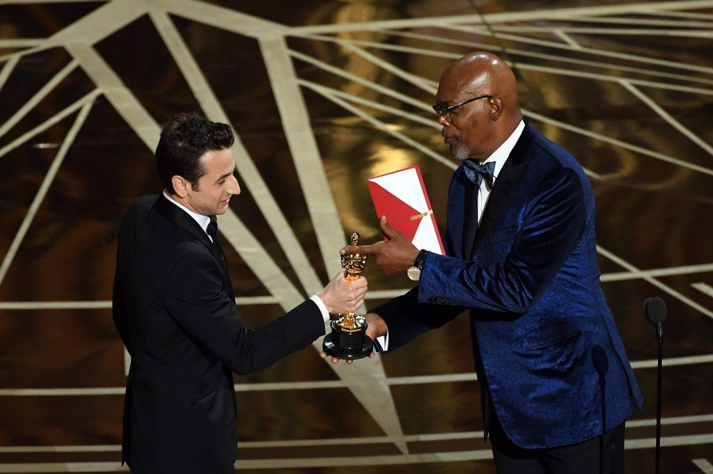 HOLLYWOOD, CA - FEBRUARY 26:  Composer Justin Hurwitz (L) accepts Best Original Score for 'La La Land' from actor Samuel L. Jackson onstage during the 89th Annual Academy Awards at Hollywood & Highland Center on February 26, 2017 in Hollywood, California.  (Photo by Kevin Winter/Getty Images)