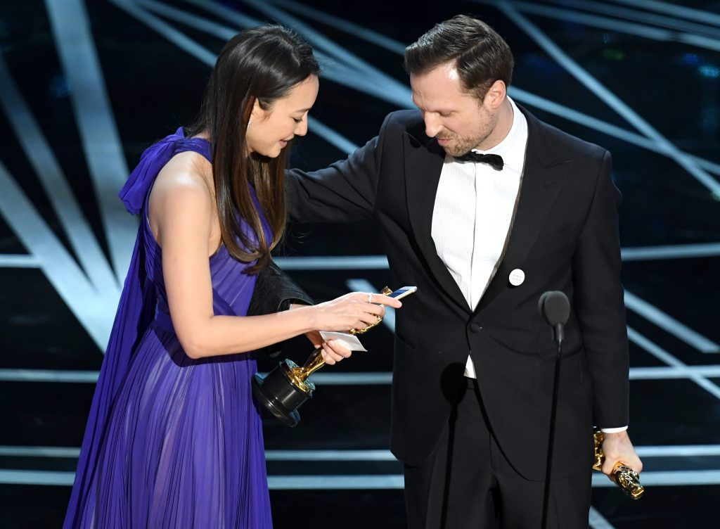 HOLLYWOOD, CA - FEBRUARY 26:  Producer Joanna Natasegara (L) and director Orlando von Einsiedel accept Best Documentary Short Subject for 'The White Helmets' onstage during the 89th Annual Academy Awards at Hollywood & Highland Center on February 26, 2017 in Hollywood, California.  (Photo by Kevin Winter/Getty Images)