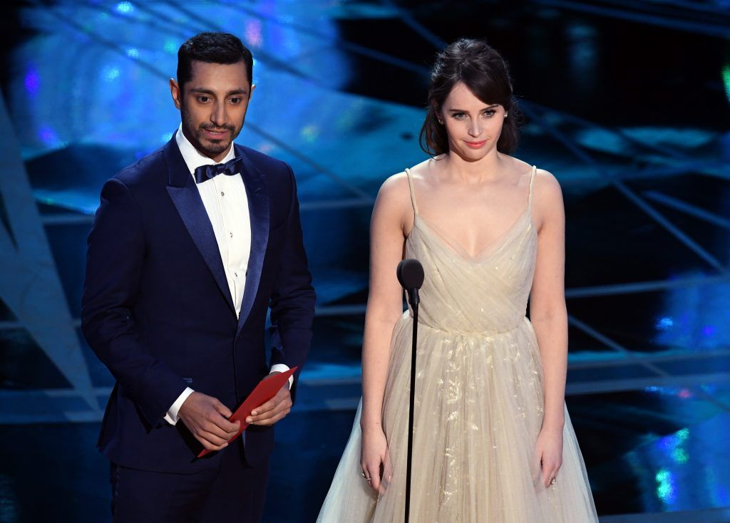 HOLLYWOOD, CA - FEBRUARY 26:  Actors Riz Ahmed (L) and Felicity Jones speak onstage during the 89th Annual Academy Awards at Hollywood & Highland Center on February 26, 2017 in Hollywood, California.  (Photo by Kevin Winter/Getty Images)