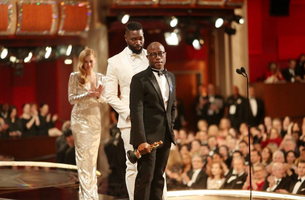 HOLLYWOOD, CA - FEBRUARY 26:  Screenwriter Tarell Alvin McCraney and writer/director Barry Jenkins accept the Best Adapted Screenplay award for 'Moonlight' from actor Amy Adams onstage during the 89th Annual Academy Awards at Hollywood & Highland Center on February 26, 2017 in Hollywood, California.  (Photo by Christopher Polk/Getty Images)