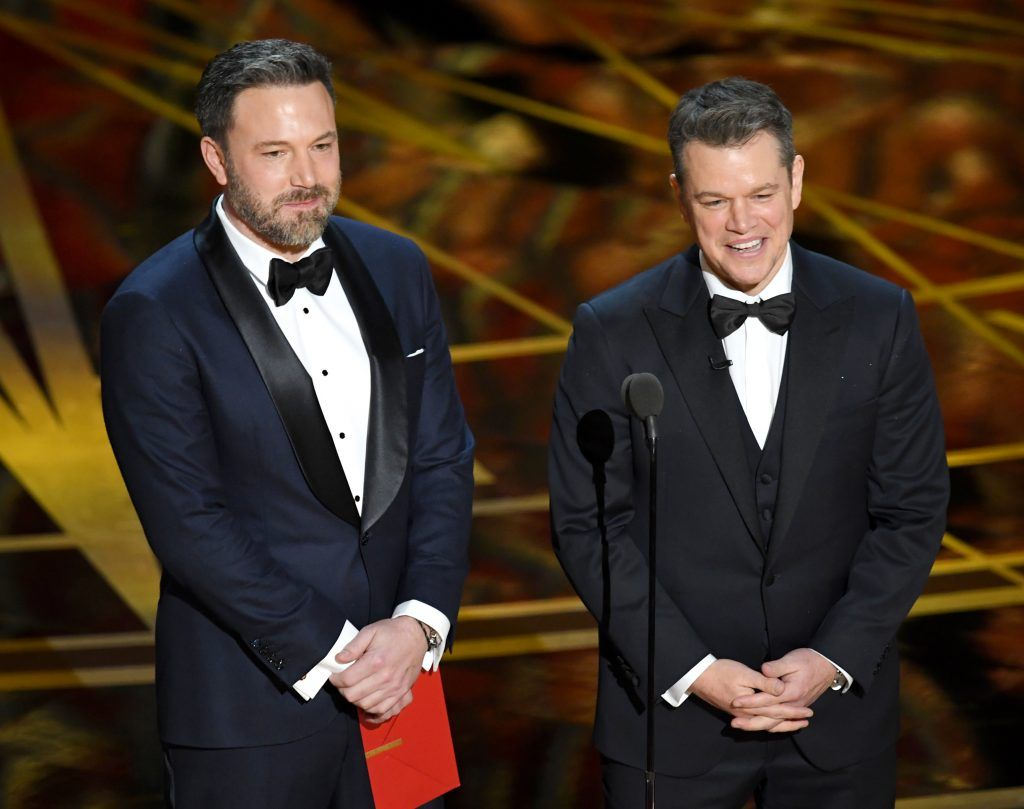 HOLLYWOOD, CA - FEBRUARY 26:  Actor/director Ben Affleck (L) and actor/producer Matt Damon speak onstage during the 89th Annual Academy Awards at Hollywood & Highland Center on February 26, 2017 in Hollywood, California.  (Photo by Kevin Winter/Getty Images)