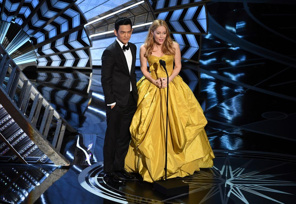 HOLLYWOOD, CA - FEBRUARY 26:  Actors John Cho (L) and Leslie Mann speak onstage during the 89th Annual Academy Awards at Hollywood & Highland Center on February 26, 2017 in Hollywood, California.  (Photo by Kevin Winter/Getty Images)