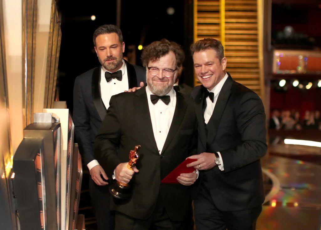 HOLLYWOOD, CA - FEBRUARY 26: Writer/director Kenneth Lonergan accepts the Best Original Screenplay award for 'Manchester by the Sea' from actors Ben Affleck and Matt Damon onstage during the 89th Annual Academy Awards at Hollywood & Highland Center on February 26, 2017 in Hollywood, California.  (Photo by Christopher Polk/Getty Images)