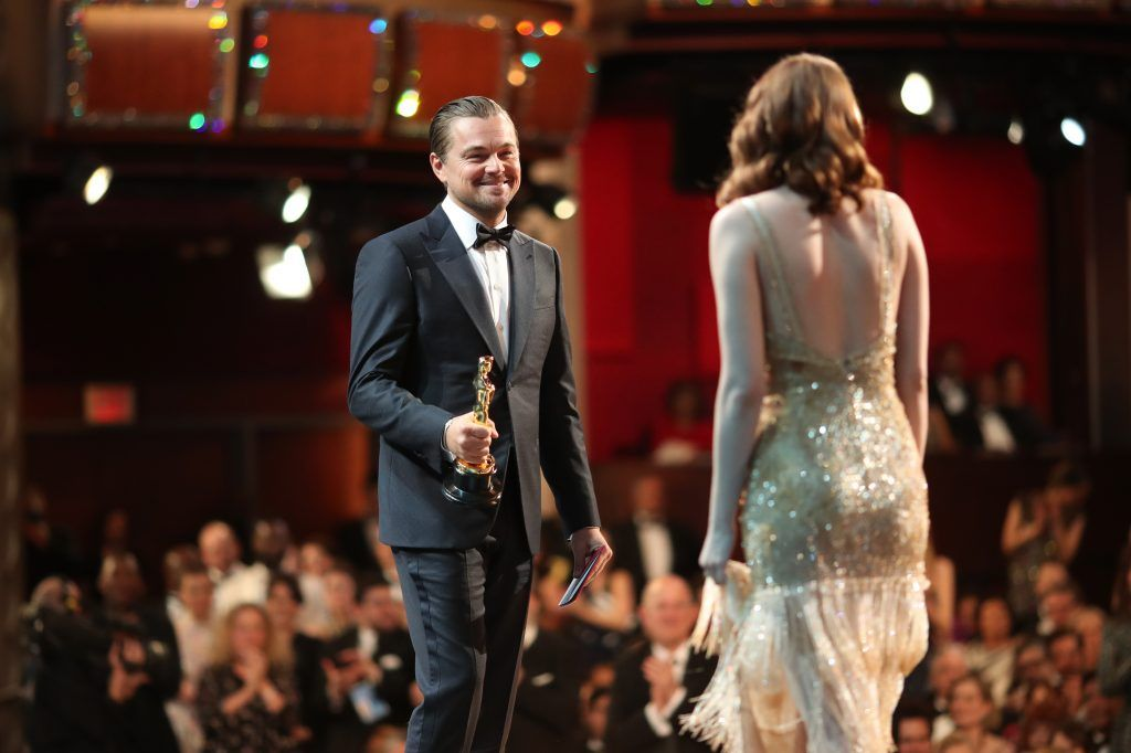 HOLLYWOOD, CA - FEBRUARY 26:  Actor Leonardo DiCaprio (L) and actress Emma Stone, winner of Best Actress for 'La La Land' onstage during the 89th Annual Academy Awards at Hollywood & Highland Center on February 26, 2017 in Hollywood, California.  (Photo by Christopher Polk/Getty Images)