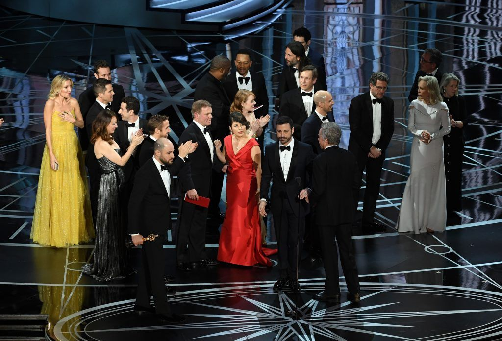 HOLLYWOOD, CA - FEBRUARY 26:  'La La Land' producer Jordan Horowitz (lower left) stops the show to announce the actual Best Picture winner as 'Moonlight' following a presentation error onstage during the 89th Annual Academy Awards at Hollywood & Highland Center on February 26, 2017 in Hollywood, California.  (Photo by Kevin Winter/Getty Images)
