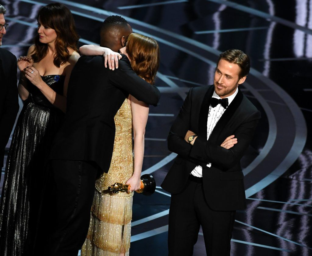 HOLLYWOOD, CA - FEBRUARY 26:  'Moonlight' actor Mahershala Ali hugs Emma Stone after it was discovered 'La La Land' was mistakenly announced as Best Picture onstage during the 89th Annual Academy Awards at Hollywood & Highland Center on February 26, 2017 in Hollywood, California.  (Photo by Kevin Winter/Getty Images)