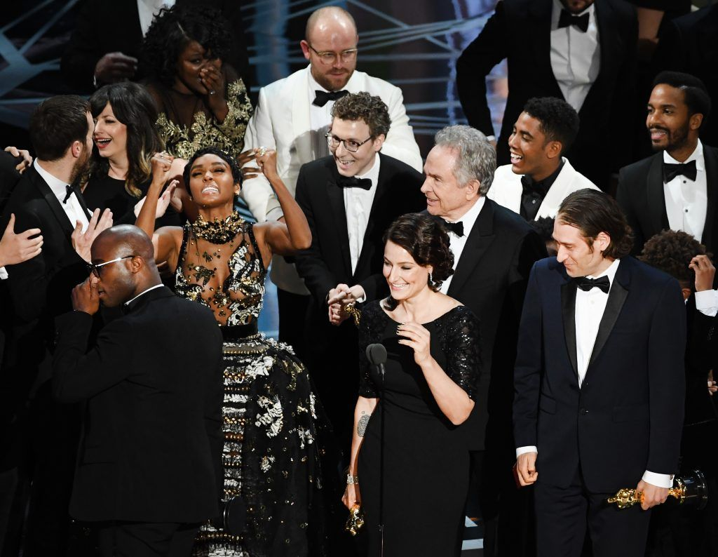 HOLLYWOOD, CA - FEBRUARY 26:  Producer Adele Romanski (C), writer/director Barry Jenkins, producer Jeremy Kleiner and cast/crew members accept Best Picture for 'Moonlight' onstage during the 89th Annual Academy Awards at Hollywood & Highland Center on February 26, 2017 in Hollywood, California.  (Photo by Kevin Winter/Getty Images)